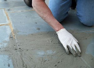 man doing concrete prep on existing floor