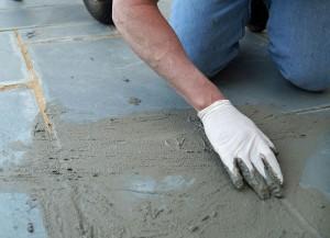 man doing concrete prep on existing floor